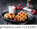 Belgian waffles with raspberries 21332901