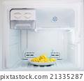 Diet fruit, pineapple dish put in freezer fridge 21335287