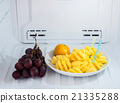 pineapple and orange dish with grape in freezer 21335288