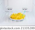 pineapple dish put on the freezer fridge 21335289