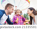 Father, mother, daughter blowing bubbles 21335501