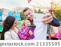 Father, mother and daughter in amusement park 21335505