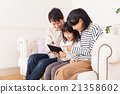 Family enjoying movies on tablet 21358602