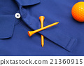Blue polo shirt and orange golf ball 21360915
