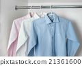 white, blue and pink clean ironed men's shirts 21361600