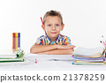 Happy school boy with pencil behind his ear 21378259