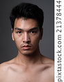 Asian man portrait with no makeup show his real skin in grey background - soft focus 21378444