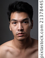 Asian man portrait with no makeup show his real skin in grey background - soft focus 21378445