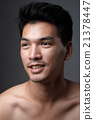 Asian man portrait with no makeup show his real skin in grey background - soft focus 21378447