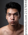 Asian man portrait with no makeup show his real skin in grey background - soft focus 21378448