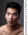 Asian man portrait with no makeup show his real skin in grey background - soft focus 21378451