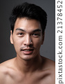 Asian man portrait with no makeup show his real skin in grey background - soft focus 21378452