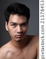 Asian man portrait with no makeup show his real skin in grey background - soft focus 21378453