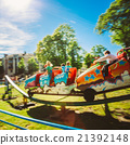 People Having Fun On Rollercoaster In Park 21392148