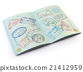 Opened passport with visa stamps on the  page 21412959