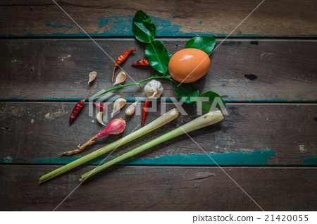 Egg and spices on wooden 21420055