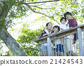 Family stand on wood deck 21424543
