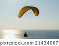 Paraglide silhouette over sea 21434967