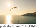 Paraglide silhouette over sea 21434968