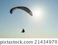 Paraglide silhouette over sea 21434970