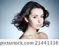 beautiful girl studio portrait with streaming hair 21441336