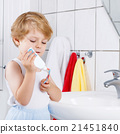 Lovely toddler boy brushing his teeth, indoors 21451840