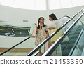Chatting on escalator 21453350