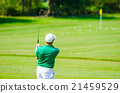 Golfer hitting golf shot. 21459529