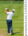 Golfer hitting golf shot. 21459531