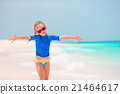Little girl at beach during summer vacation 21464617