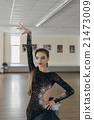 Portrait of a young girl Latin dance 21473009