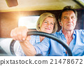 Close up of senior couple inside a pickup truck 21478672