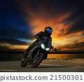 young man riding big  motorcycle 21500301