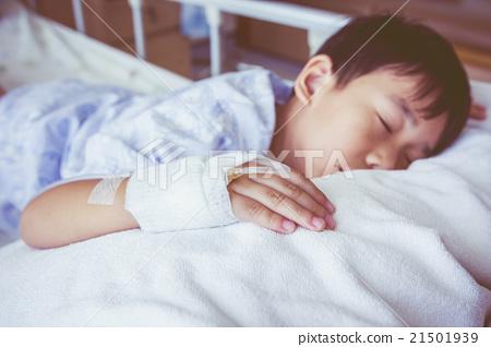 Asian boy sleeping on sickbed, saline intravenous  21501939