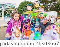 Little girl enjoying ride at fun fair, amusement 21505667