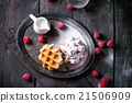 Belgian waffles with raspberries 21506909