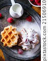Belgian waffles with raspberries 21506910