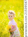 Little child playing with field flowers on spring 21509587