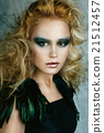 Beautiful girl in the image of bird with bright makeup,  gold ha 21512457