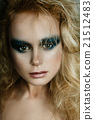 Beautiful girl in the image of bird with bright makeup,  gold ha 21512483