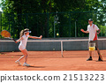 Practicing forehands 21513223