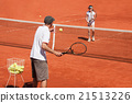 Tennis coach with his student 21513226