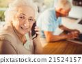 Senior woman on a phone call 21524157