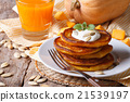 Pumpkin pancakes with sour cream and juice 21539197