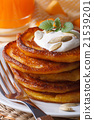 pumpkin pancakes with sour cream close-up 21539201