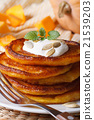 pumpkin pancakes with sour cream and mint seeds 21539203