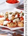 Potato gnocchi with mozzarella in tomato sauce 21539275