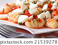 potato gnocchi with mozzarella and tomato sauce 21539278