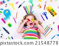 Littel girl with school supplies 21548778