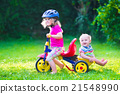 Two kids on a bike 21548990